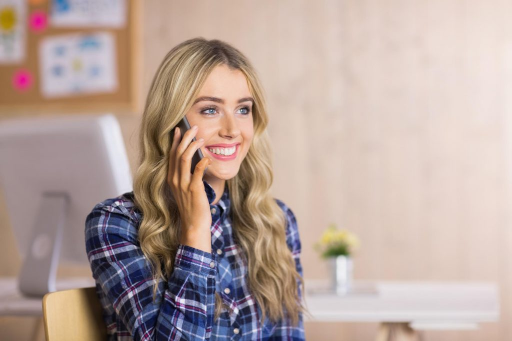 woman smiling answering phone